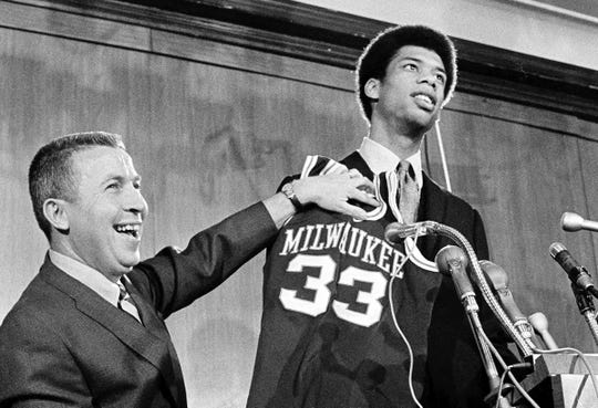 John Erickson, the Bucks general manager from 1968-70, is all smiles as he hands Kareem Abdul-Jabbar, who went by Lew Alcindor then, his jersey after the team took him with the first pick in the 1969 NBA draft.