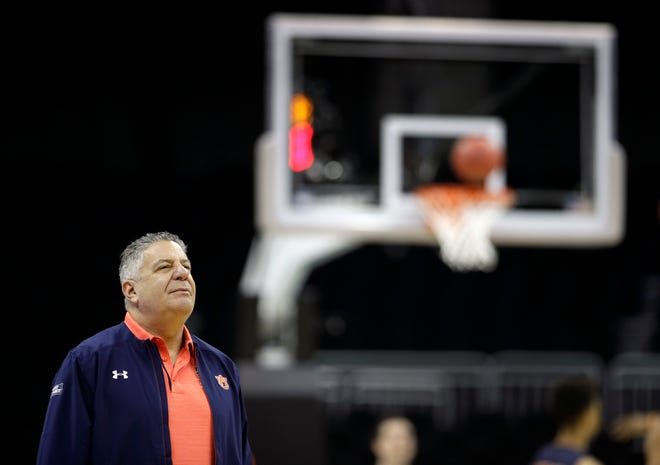 Auburn head coach Bruce Pearl watches his team during practice.