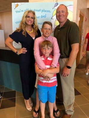 Fifth grade teacher Rayna Overmyer with her husband Matt and two children, Alan, 12, and Kade, 8.
