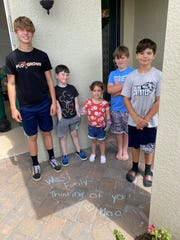 The West family, Austin, Talon, Sommer, Paxton and Mason, starting left, find a message from 5th grade teacher Rayna Overmyer.