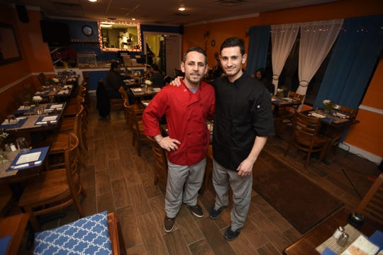 A file photo of brothers Jetmir, left, and Angelo Bushi, right, in Angelo's Greek Taverna in Maywood.