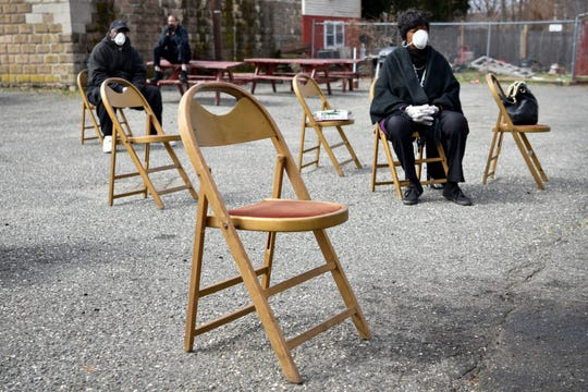 First Bethel AME Church in Paterson conducts a worship service in the church's parking lot, keeping chairs six feet apart in accordance with social distancing practice recommendations from the CDC on March 22, 2020.