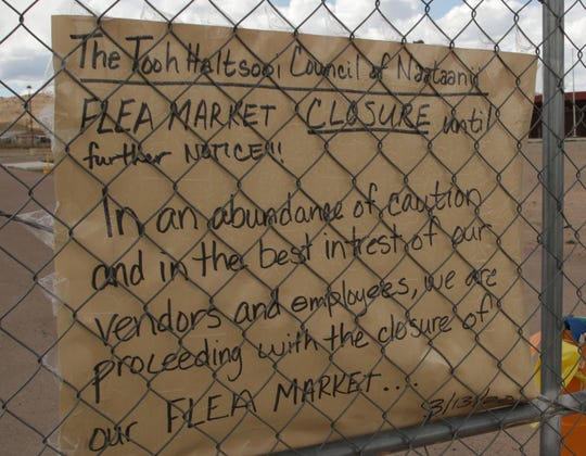 A sign informs the community about the closure of the flea market in Sheep Springs on March 21.