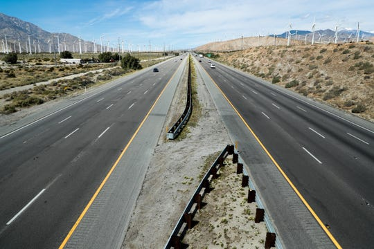 North and southbound lanes on Interstate 10 remain mostly empty on Sunday, March 22, 2020 near Palm Springs. Traffic officials say Memorial Day weekend traffic may be down compared to previous years since people are staying home during the coronavirus pandemic.