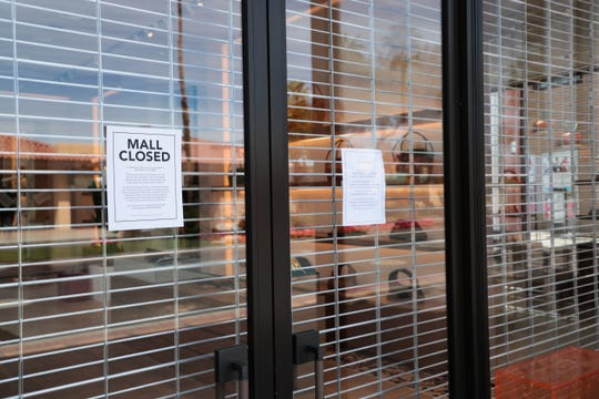 A store on El Paseo sits closed on Sunday, March 22, 2020, due to the stay-at-home order by Gov. Gavin Newsom to combat the coronavirus outbreak.