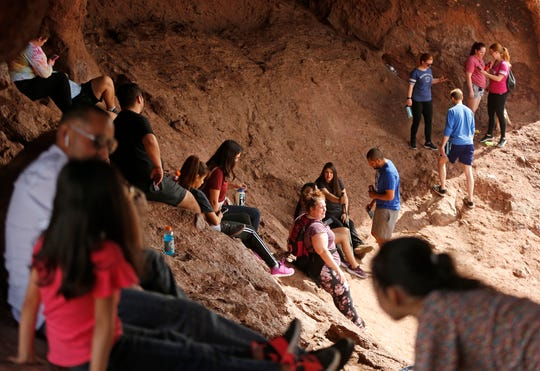 People gather at Hole in the Rock at Papago Park  on March 22, 2020.