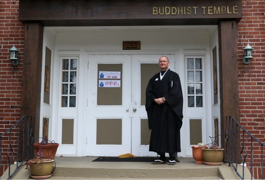 Rev. Matthew Fisher poses for a portrait in front of the Reno Buddhist Center on March 20, 2020.
