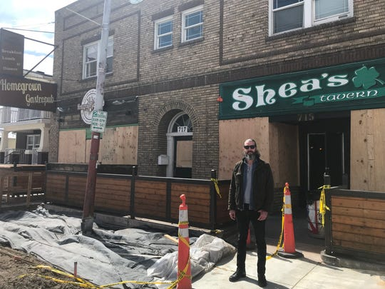 Lincoln Tice, general manager of Homegrown Gastropub, stands outside the nearby Shea's Tavern on Saturday, March 21, 2020.