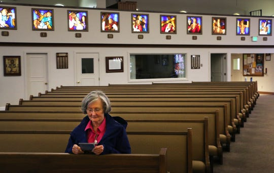 Parishioner Donna Kelly prays in solitude at Our Lady of the Snows Catholic Church in Reno on March 20, 2020. Although all masses are canceled, the church is allowing people to enter and pray from 10am until 2pm Monday through Friday and on Sundays as well.