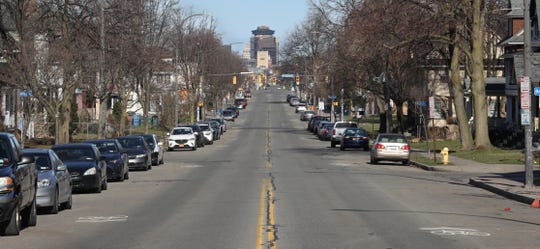 Looking northwest down Monroe Avenue towards downtown Rochester is quiet Sunday.  Hoping to stop the coronavirus pandemic, residents are staying home and staying safe.