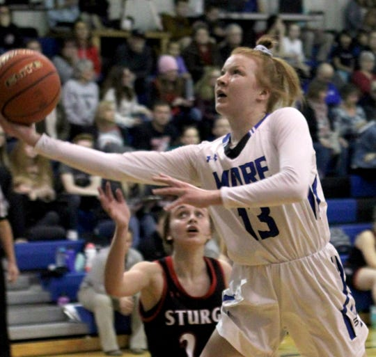 St. Thomas More junior Haleigh Timmer goes up for a shot against Sturgis.