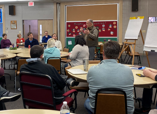 Pastor Jeff Sorensen from Dell Rapids Lutheran Church talks with volunteers at a recent Dell Rapids Relief meeting.