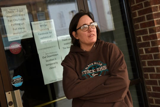 """Beth Iverson, part-time employee at Don't Spill The Beans coffee shop in Huron says the city is definitely quieter today than normal. """"It's surreal,"""" she said."""