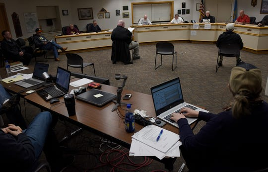 A joint city/county task force discuss the new restrictions in Huron and Beadle County based on the latest coronavirus cases. The meetings took place at the Municipal Building in Huron on Sunday, March 22.