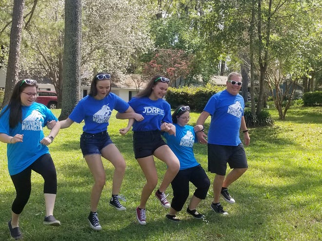 Practicing for this year's virtual JDRF Walk, which will take place Saturday, March 28. Teams will perform their walk and record it on cellphones or other devices, and broadcast them on such platforms as Facebook.