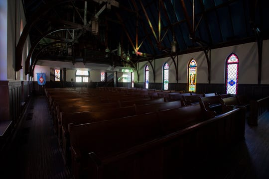The sanctuary was quiet inside St. John's Episcopal Church Sunday, March 22, 2020, as services moved to online streaming during the coronavirus pandemic.