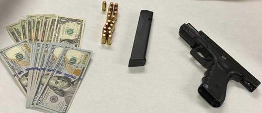 Firearm and cash seized by Oxnard police.