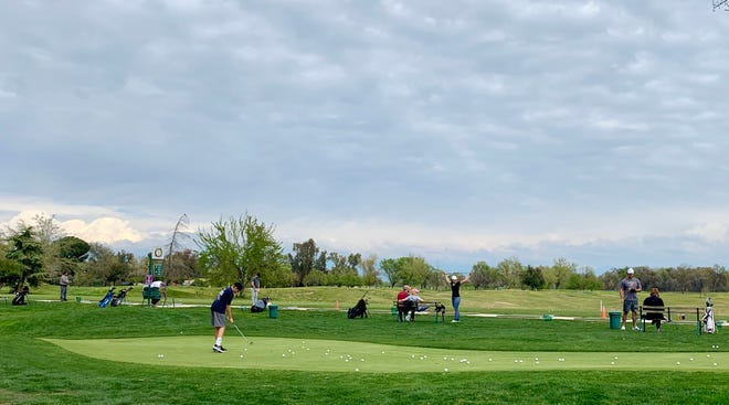 Golfers play at Valley Oaks Golf Course on Sunday, March 22, 2020. The course has stayed open after the statewide stay-at-home order issued by Gov. Newsom Thursday. The golf course has modified some of its operations to ensure social distancing and to increase sanitary practices.