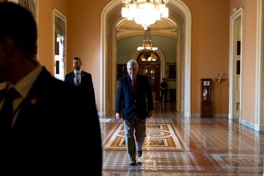 epa08312294 Senate Majority Leader Mitch McConnell (C) walks from the Senate floor to his office on Capitol Hill, in Washington, DC, USA, 21 March 2020. The Senate continues work on the third piece of legislation to provide economic relief in response to the coronavirus pandemic, with a final vote expected next week.  EPA-EFE/MICHAEL REYNOLDS ORG XMIT: MRX01
