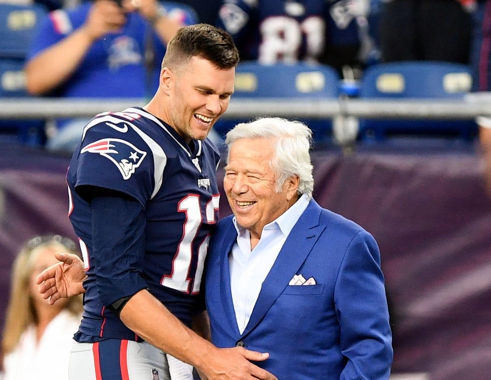 New England Patriots owner Robert Kraft greets quarterback Tom Brady before a preseason game in 2019.