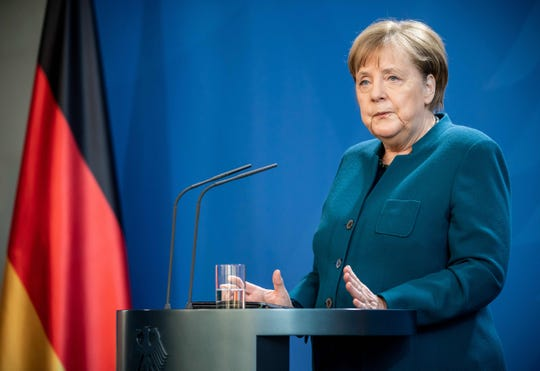 German Chancellor Angela Merkel makes a press statement on the spread of the new coronavirus COVID-19 at the Chancellery, in Berlin on March 22, 2020.