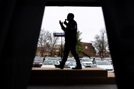 Lead pastor Kevin Rector speaks during a parking lot service at Gallatin First Church of the Nazarene in Gallatin, Tenn., Sunday, March 22, 2020.
