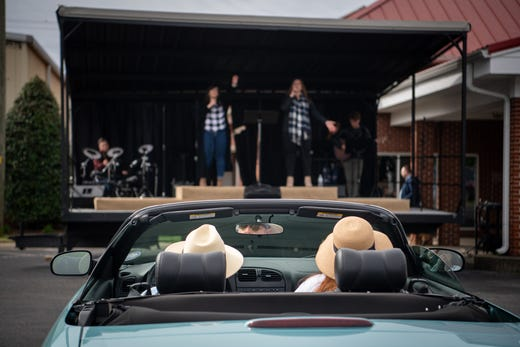 Congregants listen to the service from their parked cars during a parking lot service at Gallatin First Church.