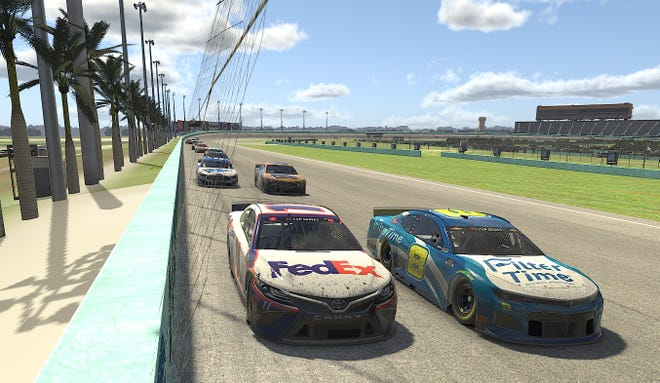 In this computer-generaged in-game image, Denny Hamlin, left, races Dale Earnhardt Jr. (8), during the eNASCAR iRacing Pro Invitational Series Dixie Vodka 150 at virtual Homestead-Miami Speedway.