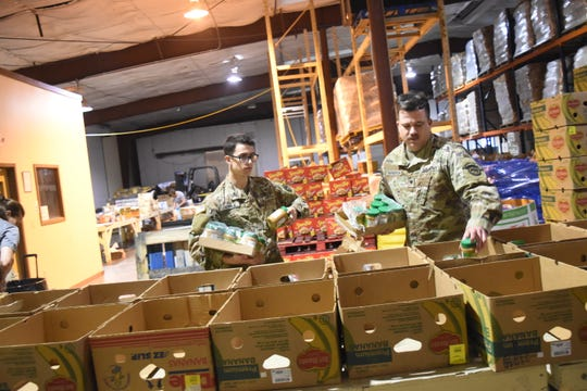 Members of the Louisiana National Guard's 527th Engineer Battalion, along with the 256th Infantry Brigade and the 139th Regional Support Group, help with a program to distribute food to senior citizens Monday at the Food Bank of Central Louisiana. The National Guard might be used with a new program to feed students who are at home during the COVID-19 closure, at least in Avoyelles Parish.