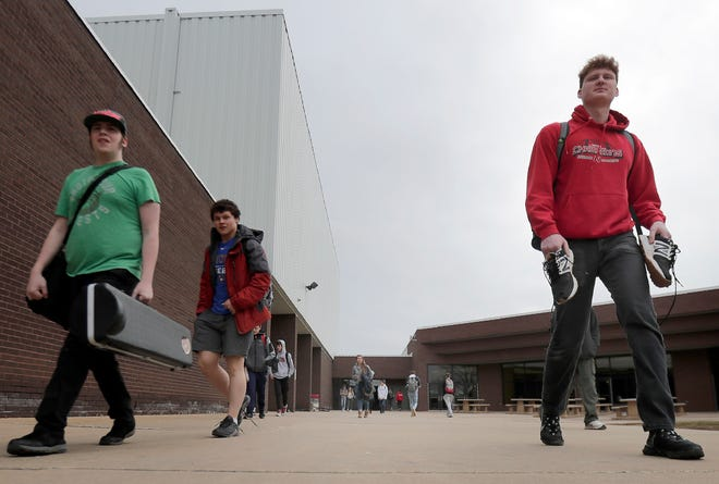 Students leave Neenah High School on March 16 in Neenah.