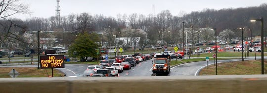 Cars line up at PNC Bank Arts Center in Holmdel waiting for a COVID-19 test being done there Monday, March 23.