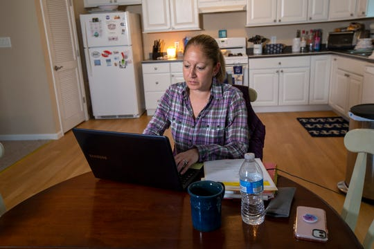 Mindy Patrisso of West Caldwell, who is a school social worker, works vitually from her family's second home in Ship Bottom, NJ  during the Coronavirus crisis Monday March 23, 2020.