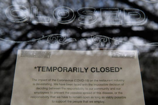 Asheville restaurants, like Curate, pictured, had signs alerting customers of their availability as businesses shut down in the midst of the coronavirus March 18, 2020.