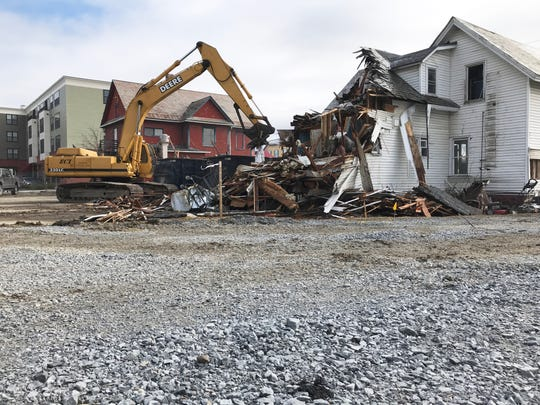 A crew from ECI (Engineers Construction) demolishes an old home near Five Corners in Essex Junction on March 19, 2020.