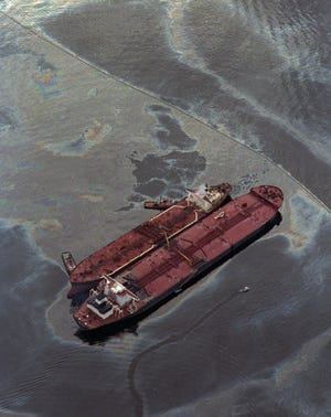 The smaller Exxon Baton Rouge attempts to off-load crude oil March 26,1989, from the Exxon Valdez, aground in Alaska's Prince William Sound. The tanker spilled 11 million gallons of crude in America's worst oil spill.