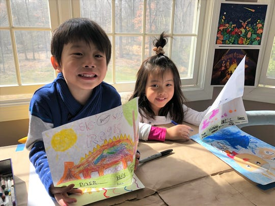 Regis and Reina Chen working together on an art project