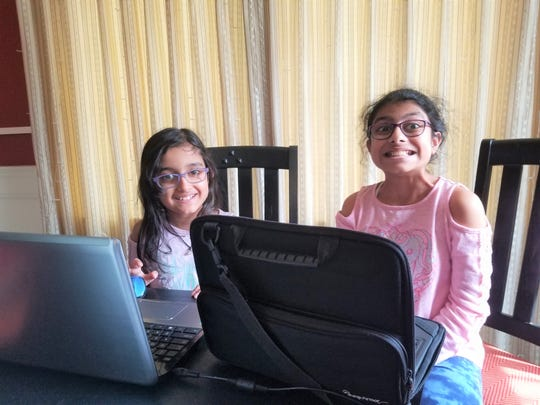 Kimaya and Namya Singh work together to compete their flexible instruction