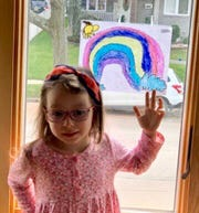 Students and staff members created artwork on their doors and windows for the community to see as a message that everyone is facing this challenge together.