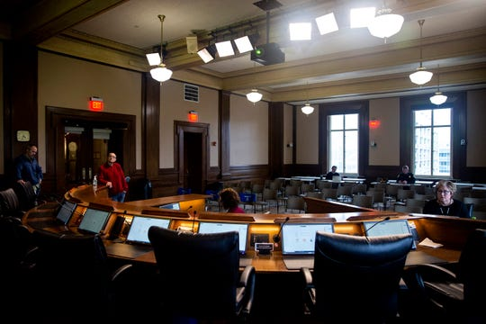 The Des Moines city council chamber is mostly empty during a virtual council meeting on Monday, March 23, 2020, at City Hall in Des Moines' East Village. The City Council held the virtual meeting, participating from their homes, because of the coronavirus.