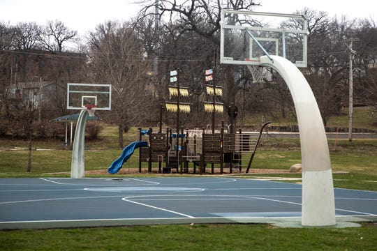 The playground equipment sits unused at Columbus Park on Monday, March 23, 2020, in Des Moines. The city is asking people to stay off the equipment to limit the spread of the coronavirus.