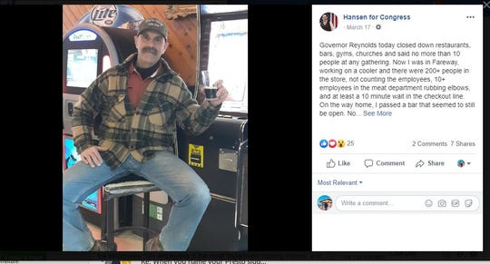 Thomas Hansen, one of two Republicans competing against Rep. Abby Finkenauer in Iowa's 1st District, on March 17 posted a photo of himself on social media drinking a beer in a local restaurant that he said was defying the governor's order.