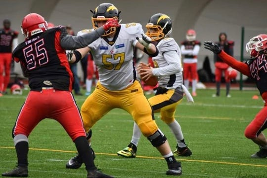Former Grand Rapids Christian offensive lineman Tommy Doles plays for the Flash La Courneuve in France.