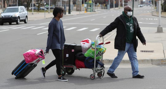 Jeffrey Denson and Nahla Hamilton  move Nahla's  belongings out of the Leon H. Atchison building at Wayne State  University on Sunday.  Wayne State officials said Sunday that a student there has tested positive.