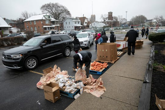 "A Gleaners food handout was possible with the help of volunteers from Focus Hope outside of B. Benedict Glazer Elementary School in Detroit on March 23, 2020, just before the Governor of Michigan ordered a ""Stay-at-Home Order"" to help lower the curve on the spread of the Novel Coronavirus."