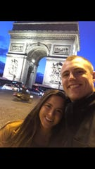Former Grand Rapids Christian offensive lineman Tommy Doles and his wife, Bethany, pose by the Arc de Triomphe in Paris.