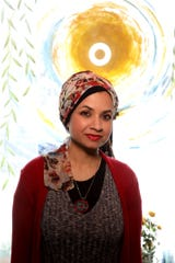 Shazia Siddiqi, the owner of Let's Art About It in Clawson, Michigan inside her business on Friday, March 20, 2020.