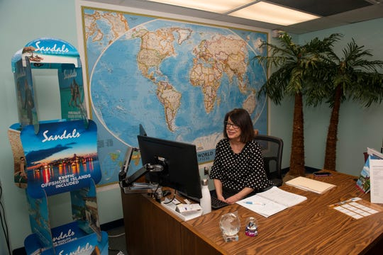 Travel agent Pamela Nikitas, president of Joan Anderson Travel Service, Inc., works out of her office on the lobby level of the historic Buhl building in downtown Detroit. Following Gov. Whitmer's stay-at-home order, Nikitas will lock up her downtown office until at least April 13th and work from her home in Troy.