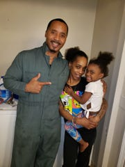 Photo #1: Personal trainer, Maurice Richardson, left, and his cousin, Lisa Mills (not shown) deliver new dryer to Jazmin Diggs, center, and family photo by Lisa Mills