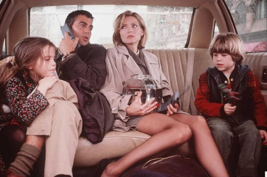 """Mae Whitman, George Clooney, Michelle Pfeiffer and Alex D. Linz in """"One Fine Day."""""""