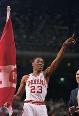 In this March 30, 1987 photo, Indiana's Keith Smart gives the number one sign after Indiana won the NCAA college basketball championship against Syracuse in New Orleans.  Indiana defeated Syracuse 74-73.